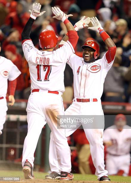 Brandon Phillips of the Cincinnati Reds celebrates with ShinSoo Choo after Choo scored the winning run in the 9th inning against the Los Angeles...