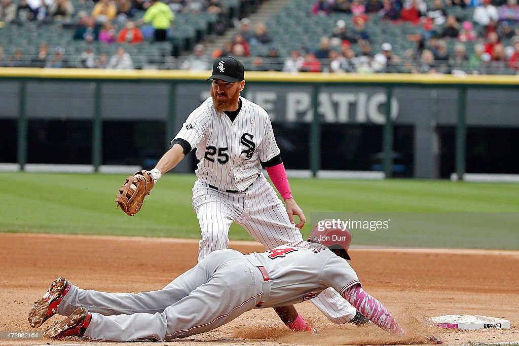Brandon Phillips #4 of the Cincinnati Reds dives safely into first while Adam LaRoche #25 of the Chicago White Sox takes the throw during the fourth inning on May 10, 2015 at U.S. Cellular Field in Chicago, Illinois.