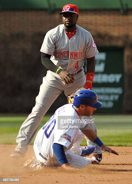 Brandon Phillips of the Cincinnati Reds forces out Mike Olt of the Chicago Cubs during the seventh inning on April 20 2014 at Wrigley Field in...