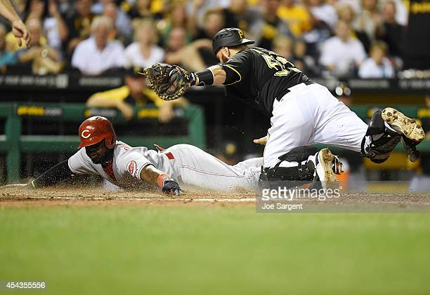 Brandon Phillips of the Cincinnati Reds is tagged out at home plate by Russell Martin of the Pittsburgh Pirates during the eighth inning on August 29...