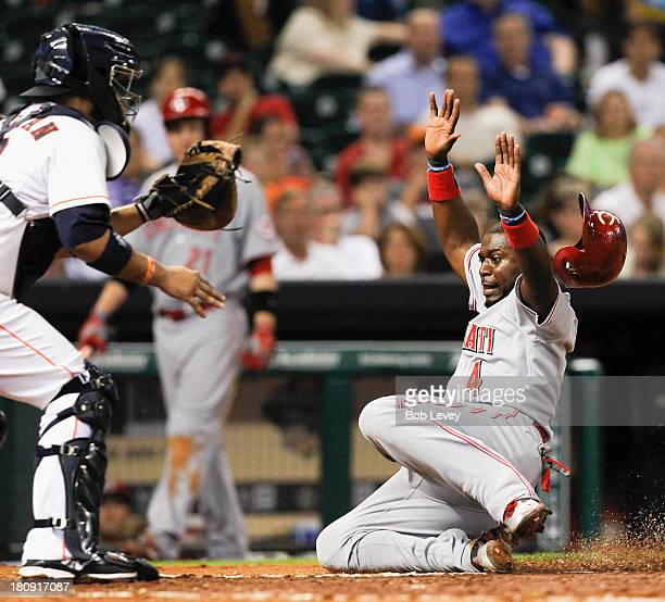 Brandon Phillips of the Cincinnati Reds is tagged out by catcher Carlos Corporan of the Houston Astros as he tried to score in the sixth inning at...