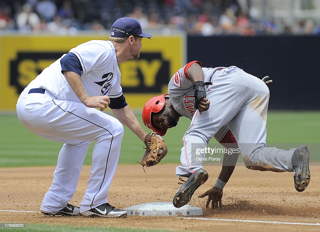 Brandon Phillips #4 of the Cincinnati Reds is tagged out by Chase Headley #7 of the San Diego Padres as he's caught stealing third base during the third inning of a baseball game at Petco Park on July 31, 2013 in San Diego, California.