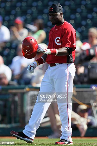 Brandon Phillips of the Cincinnati Reds reacts after being caight out in the fourth inning against the Cleveland Indians during a spring training...