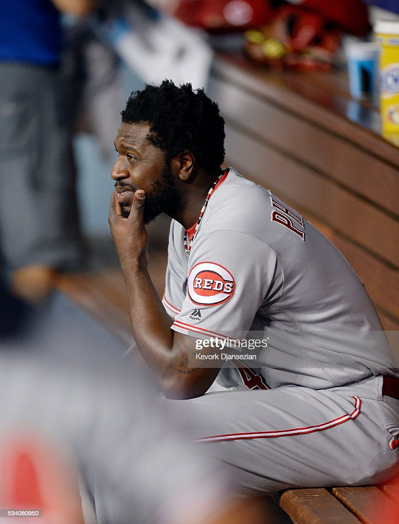 Brandon Phillips #4 of the Cincinnati Reds reacts in the dugout after the Los Angeles Dodgers defeated the Reds, 8-2, at Dodger Stadium May 24, 2016, in Los Angeles, California.