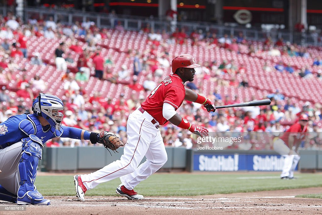 Brandon Phillips #4 of the Cincinnati Reds singles to drive in a run in the first inning of the game against the Chicago Cubs at Great American Ball Park on July 8, 2014 in Cincinnati, Ohio.