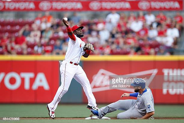 Brandon Phillips of the Cincinnati Reds tries to turn a double play against Mike Moustakas of the Kansas City Royals in the second inning of the game...