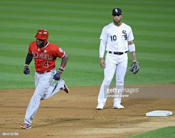Brandon Phillips of the Los Angeles Angels runs the bases past Yoan Moncada of the Chicago White Sox after hitting a two run home run in the 2nd...