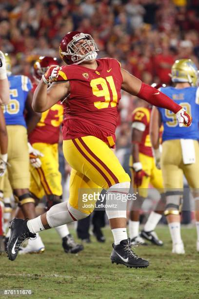 Brandon Pili of the USC Trojans celebrates after the UCLA Bruins miss a field goal during the NCAA college football game at the Los Angeles Memorial...