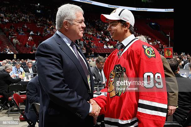 Brandon Pirri of the Chicago Blackhawks shakes hands with Blackhawks General Manager Dale Tallon after Pirri was drafted in the second round of the...