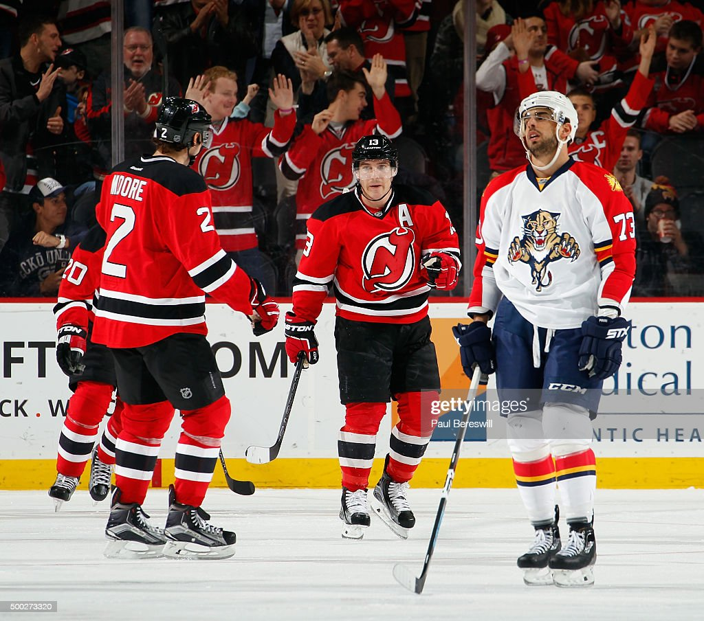 Brandon Pirri #73 of the Florida Panthers looks up frustrated as the Devils and their fans cheer a goal by Mike Cammalleri #13 of the New Jersey Devils during the third period of an NHL hockey game at Prudential Center on December 6, 2015 in Newark, New Jersey. Devils won 4-2.