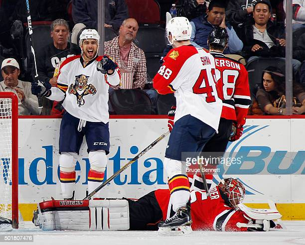 Brandon Pirri of the Florida Panthers scores at 2:42 of the second period against Cory Schneider of the New Jersey Devils and points to Logan Shaw...