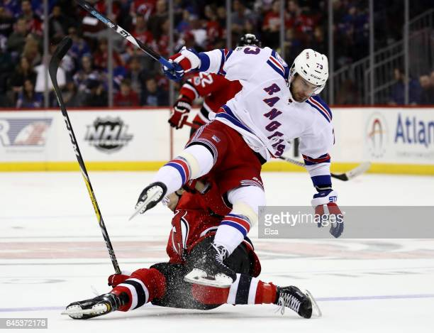 Brandon Pirri of the New York Rangers and Joseph Blandisi of the New Jersey Devils collide in the second period on February 25, 2017 at Prudential...
