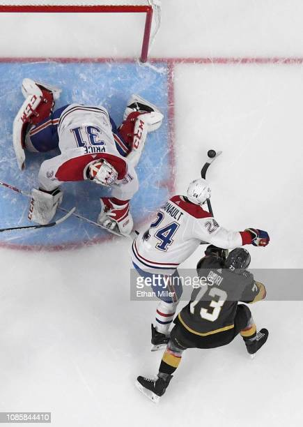 Brandon Pirri of the Vegas Golden Knights corrals a rebound and scores a first-period goal against Carey Price and Phillip Danault of the Montreal...