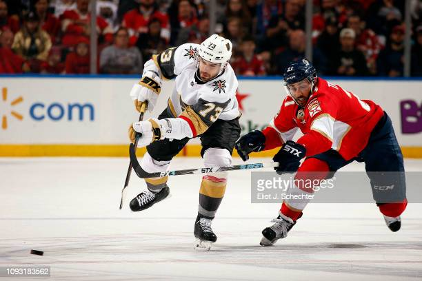 Brandon Pirri of the Vegas Golden Knights skates for possession against Vincent Trocheck of the Florida Panthers at the BB&T Center on February 2,...