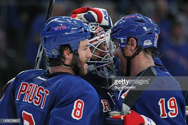 Brandon Prust Henrik Lundqvist and Brad Richards of the New York Rangers celebrate their 3 to 1 win over the Washington Capitals in Game One of the...