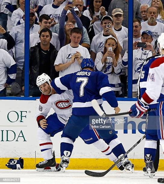 Brandon Prust of the Montreal Canadiens fights with Radko Gudas of the Tampa Bay Lightning in Game Two of the First Round of the 2014 Stanley Cup...