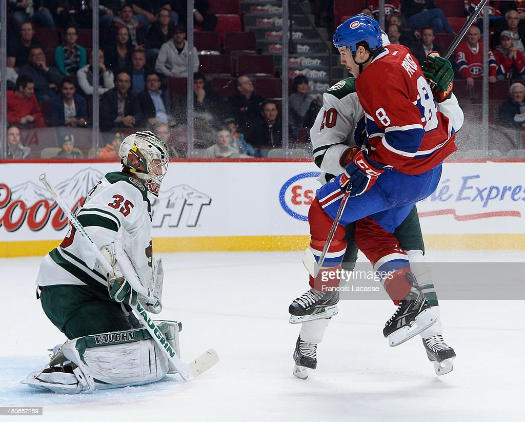 Brandon Prust #8 of the Montreal Canadiens jumps to clear the path of the puck shot towards Darcy Kuemper #35 of the Minnesota Wild during the NHL game on November 19, 2013 at the Bell Centre in Montreal, Quebec, Canada.
