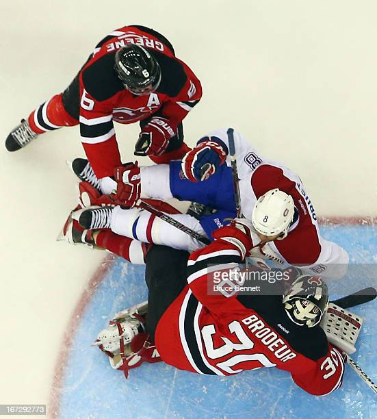 Brandon Prust of the Montreal Canadiens runs into Martin Brodeur of the New Jersey Devils as Andy Greene helps defend at the Prudential Center on...