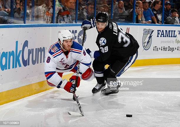 Brandon Prust of the New York Rangers dives to get to the puck before Mike Lundin of the Tampa Bay Lightning during the second period at the St Pete...