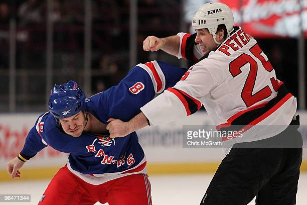 Brandon Prust of the New York Rangers fights with Andrew Peters of the New Jersey Devils during their game on February 6 2010 at Madison Square...