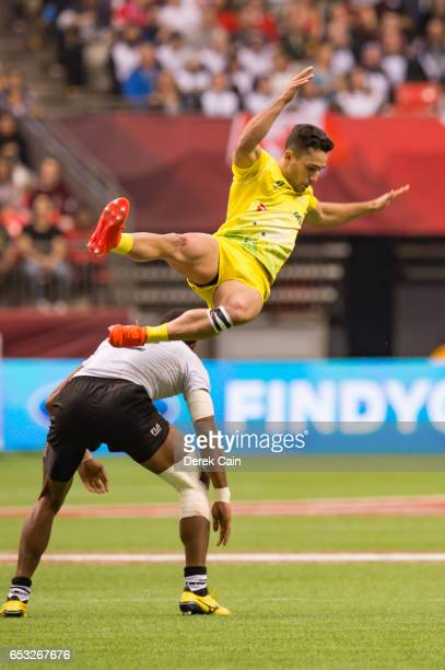 Brandon Quinn of Australia gets sideways in the air after coming in contact with Apisai Domolailai of Fiji during day 2 of the 2017 Canada Sevens...