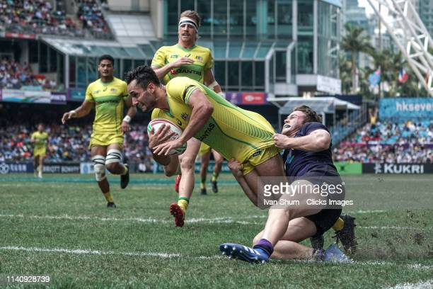 Brandon Quinn of Australia score a try during Challenge Trophy Semi Finals between Scotland and Australia on day three of the Cathay Pacific/HSBC...