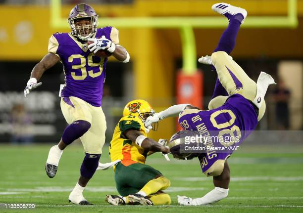 Brandon Radcliff of the Atlanta Legends runs with the ball as teammate CharlesStandberry, Jr. #80 falls to the ground against the Arizona Hotshots...