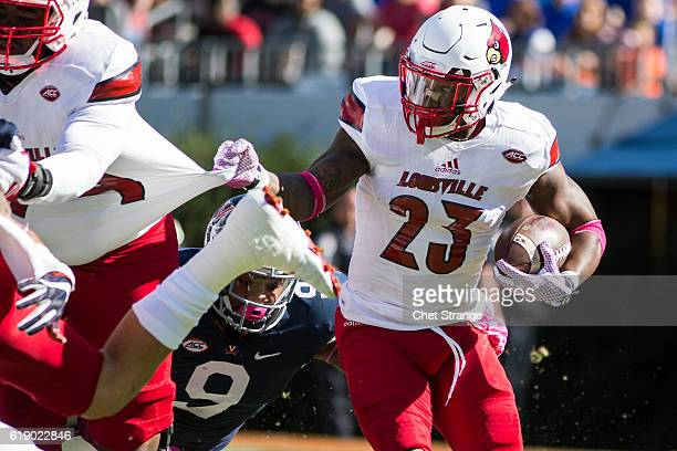 Brandon Radcliff of the Louisville Cardinals runs the ball during Louisville's game against the Virginia Cavaliers at Scott Stadium on October 29...