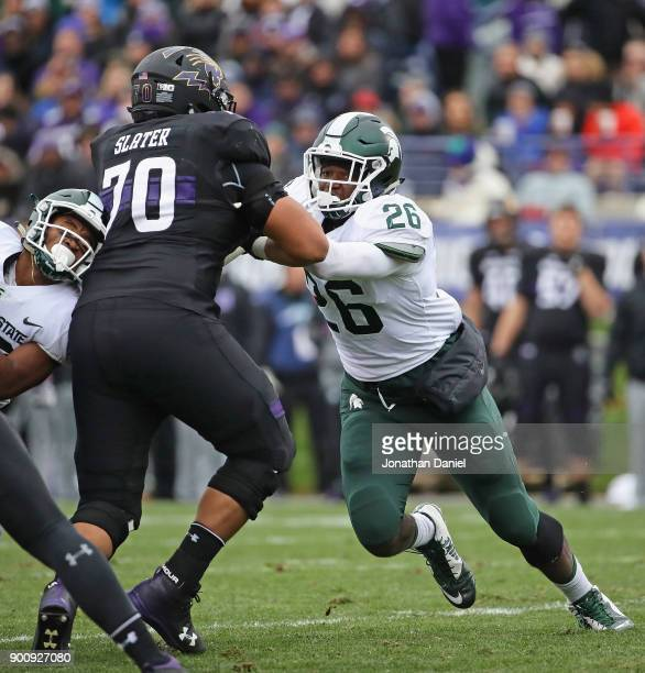 Brandon Randle of the Michigan State Spartans rushes against Rashawn Slater of the Northwestern Wildcats at Ryan Field on October 28, 2017 in...
