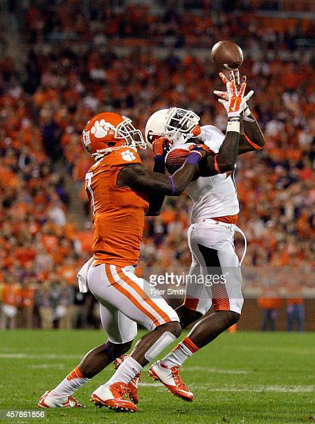 Brandon Reddish of the Syracuse Orange intercepts a pass over Mike Williams of the Clemson Tigers during the game at Memorial Stadium on October 25...