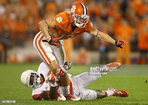 Brandon Reddish of the Syracuse Orange tackles Adam Humphries of the Clemson Tigers during their game at Memorial Stadium on October 25 2014 in...