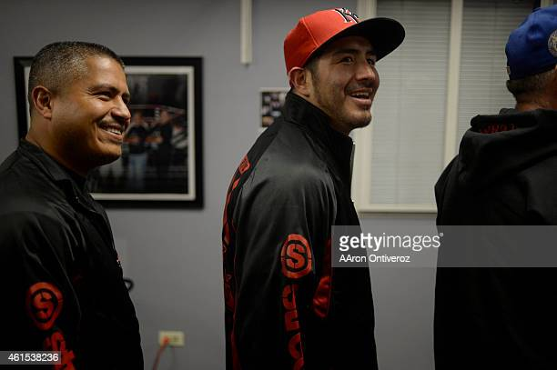 Brandon Rios and his trainer Robert Garcia leave the gym after media day. Media day for Mike Alvarado and Brandon Rios in preparation for their third...