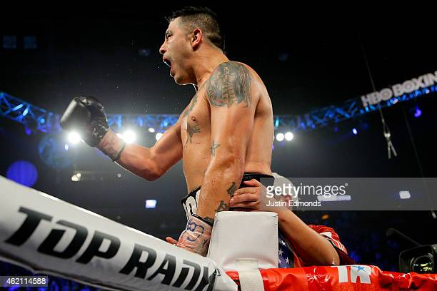 Brandon Rios celebrates after his fight against Mike Alvarado during a WBO International Welterweight Title fight at First Bank Center on January 24,...