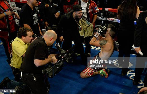 Brandon Rios celebrates kneels down after his win over Mike Alvarado for the WBO International Welterweight Title January 24, 2015 at 1st Bank Arena.