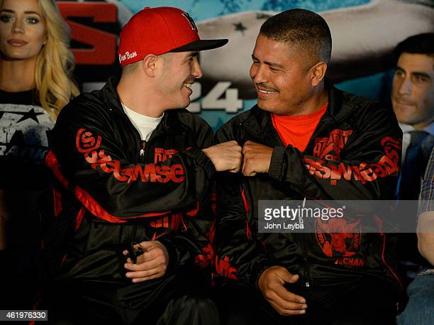 Brandon Rios fist bumps his trainer Robert Garcia during a press conference with Mike Alvarado January 22, 2015 for the upcoming WBO International...