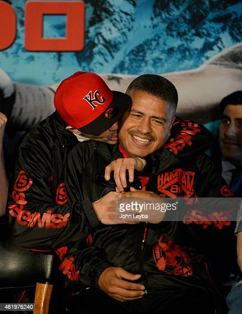 Brandon Rios hugs his trainer Robert Garcia during a press conference with Mike Alvarado January 22, 2015 for the upcoming WBO International...