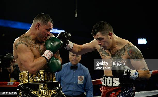 Brandon Rios lands a punch on Mike Alvarado during the WBO International Welterweight Title January 24, 2015 at 1st Bank Arena.