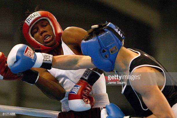 Brandon Rios scores a bodyshot against Danny Williams during the United States Olympic Team Boxing Trials at Battle Arena on February 19 2004 in...