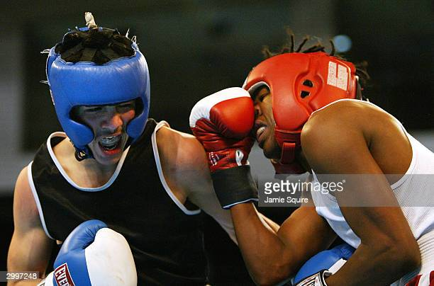 Brandon Rios scores a bodyshot against Danny Williams during their bout in the United States Olympic Team Boxing Trials on February 19 2004 at Tunica...