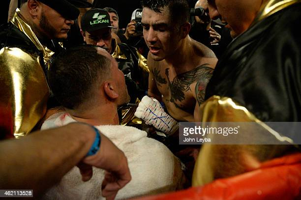 Brandon Rios talks to Mike Aleravdo inches corner after his win for the WBO International Welterweight Title January 24, 2015 at 1st Bank Arena.
