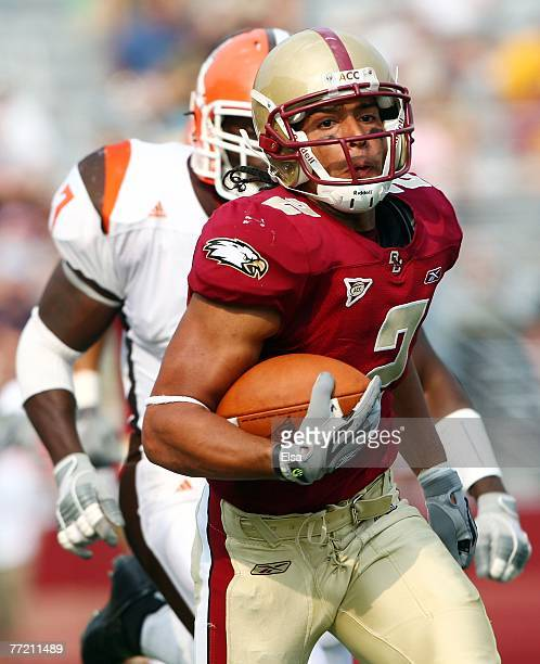Brandon Robinson of the Boston College Eagles carries the ball in the fourth quarter as Freddie Barnes of the Bowling Green Falcons defends on...