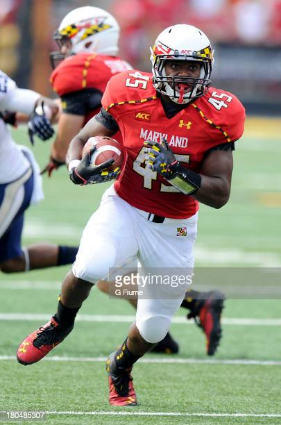 Brandon Ross of the Maryland Terrapins rushes the ball against the Old Dominion Monarchs at Byrd Stadium on September 7 2013 in College Park Maryland