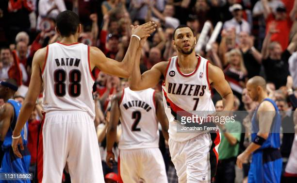 Brandon Roy high fives Nicolas Batum of the Portland Trail Blazers against the Dallas Mavericks in Game Four of the Western Conference Quarterfinals...
