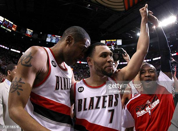 Brandon Roy of the Portland Trail Blazers celebrates with teammates Marcus Camby and Armon Johnson after overcoming a 23 point deficit to defeat the...