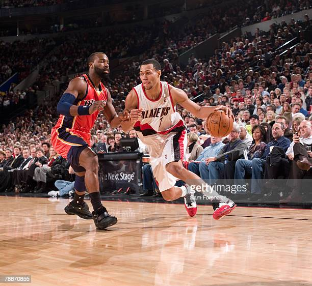 Brandon Roy of the Portland Trail Blazers drives around Baron Davis of the Golden State Warriors during a game on January 9 2008 at the Rose Garden...