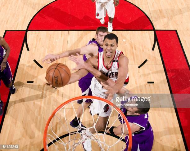 Brandon Roy of the Portland Trail Blazers drives to the basket for a layup against Spencer Hawes and Brad Miller of the Sacramento Kings during the...