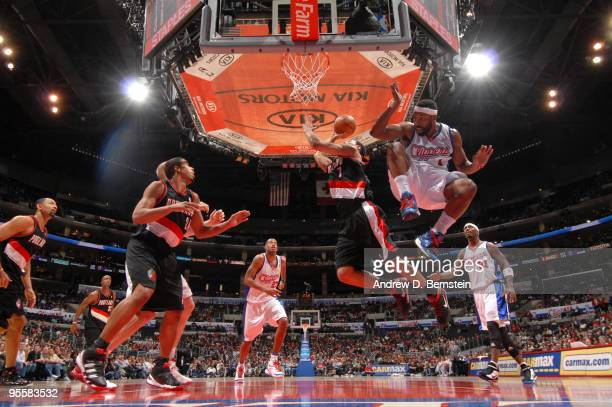 Brandon Roy of the Portland Trail Blazers goes up for a basket while Baron Davis of the Los Angeles Clippers leaps to avoid contact during their game...