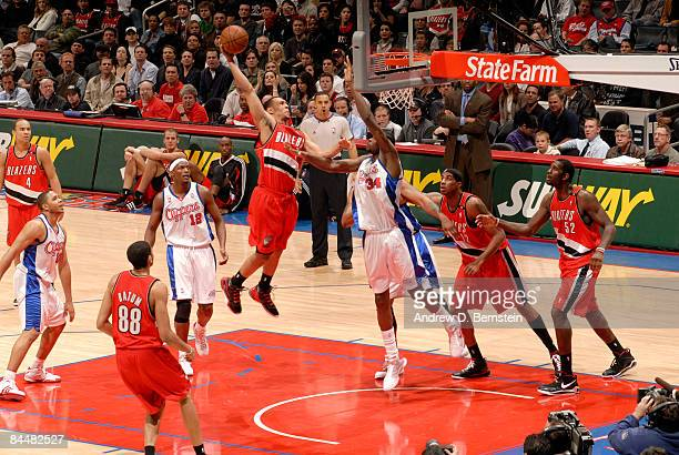 Brandon Roy of the Portland Trail Blazers goes up for a dunk against Cheikh Samb of the Los Angeles Clippers at Staples Center on January 26 2009 in...
