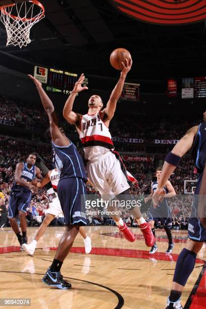 Brandon Roy of the Portland Trail Blazers goes up for a shot past CJ Miles of the Utah Jazz during a game on February 21 2010 at the Rose Garden...