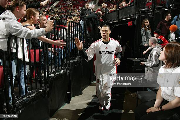 Brandon Roy of the Portland Trail Blazers greets fans as he runs out of the tunnel prior to the game against the Boston Celtics at The Rose Garden on...